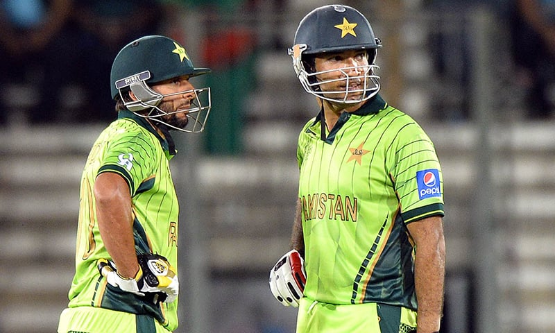Pakistan batsmen Shahid Afridi (L) and Sohaib Maqsood look on during a one-day international 2015 World Cup. (Photo- AFP)