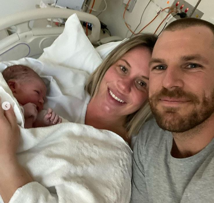 Aaron and Amy Finch with their newborn Esther Kate.  Photo- Instagram